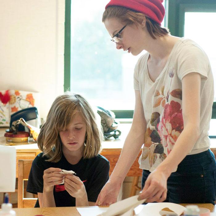 Art Education student helping grad school child