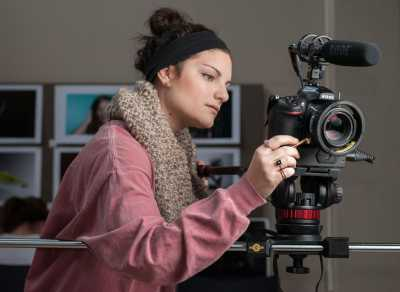 Commercial photography student with camera