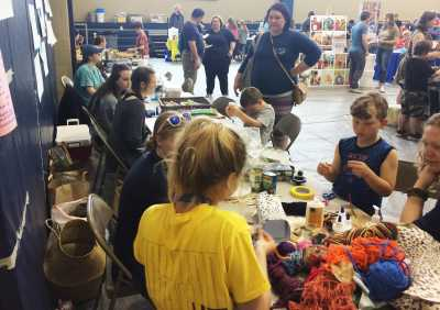 Elementary Ed. students work with young people to create environmental artwork with recycled materials at the BUILD Fest event in Boone.