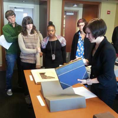 Examining 19th century photographs at the Rubenstein Special Collections Library at Duke University