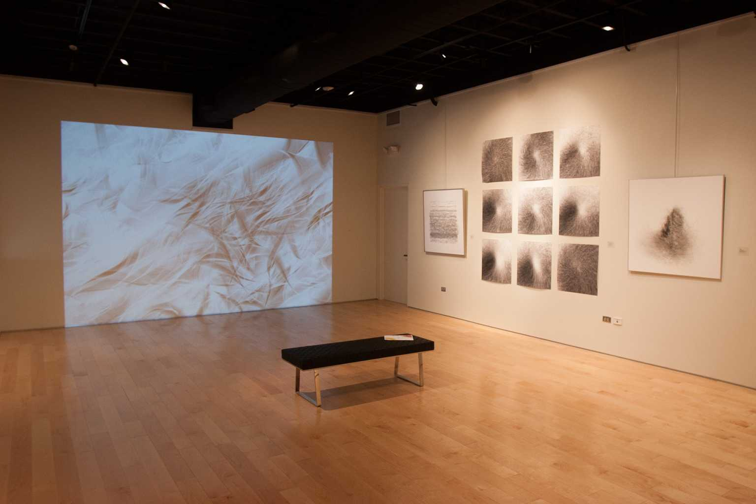 Installation view of Air Current(s) and prints of wind drawings