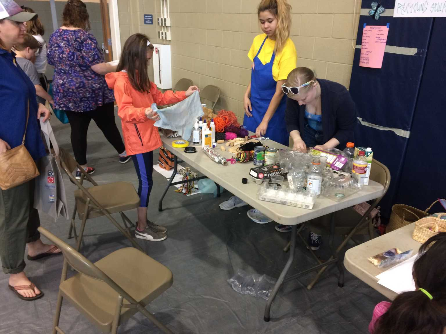 Elementary Ed. students work with young people to create environmental artwork with recycled materials at the BUILD Fest event in Boone