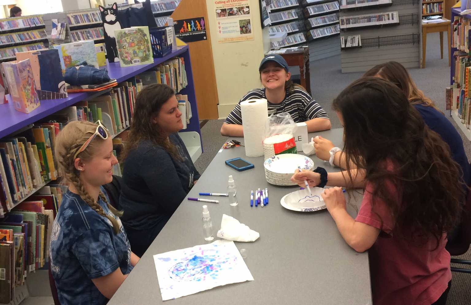 Elementary Ed. students work with young people to create environmental artwork with recycled materials at the Watauga Public Library.