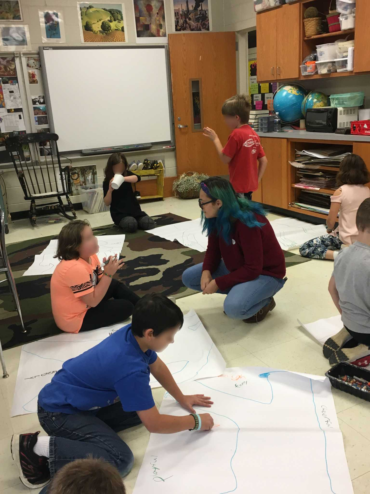Cami Truitt helps 3rd grade students formulate ideas during her field experience.