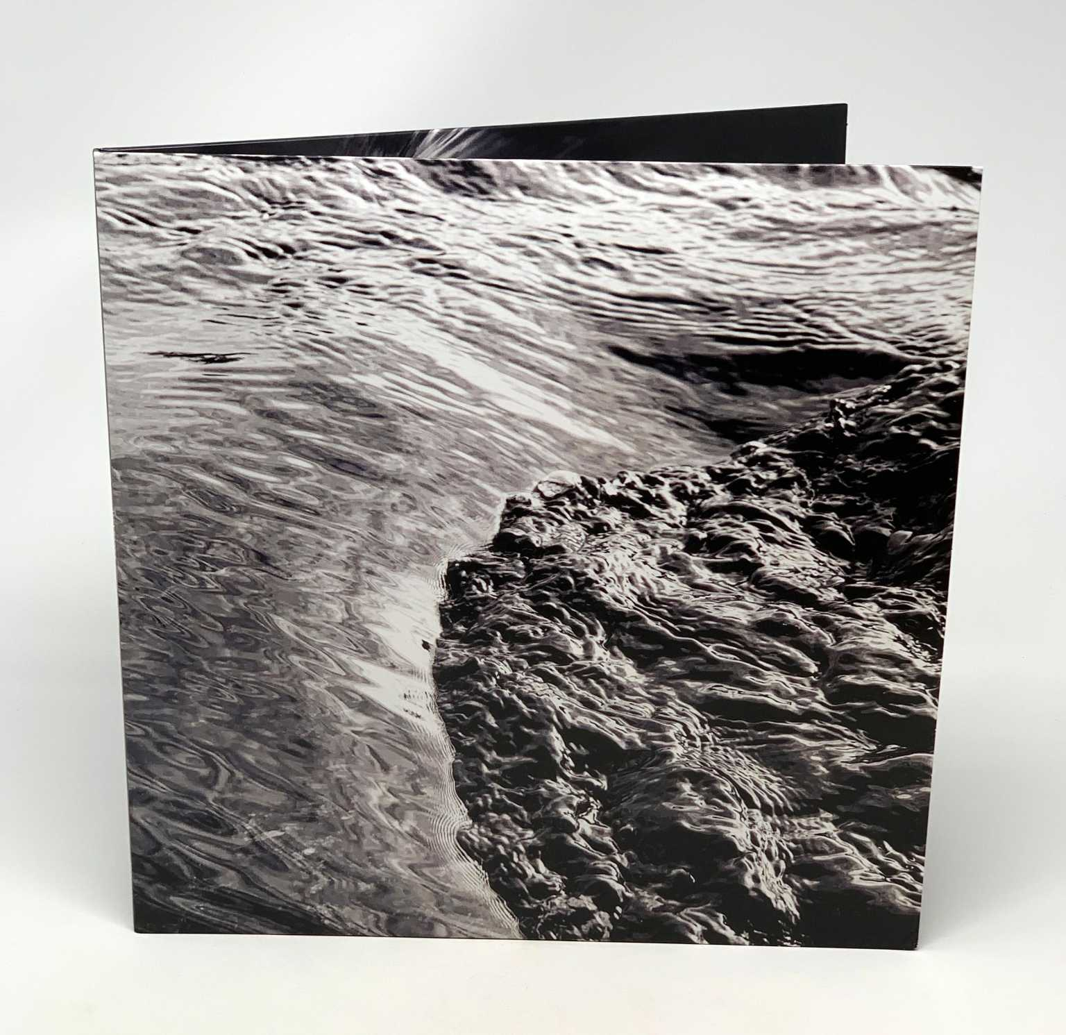 Running water photograph on cover of Alex Banks' album, Beneath the Surface